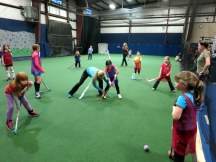 Courtney Cappallo teaches correct form during a U10 instructional clinic