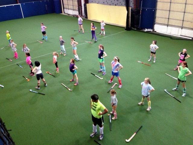 Cape Cod Youth Field Hockey holding Power Pose
